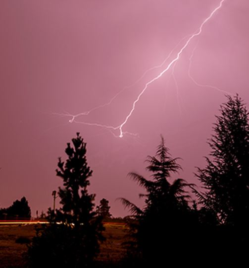 LIghtning in a pinkish sky